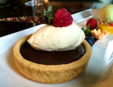 Milk Chocolate Tart with Pistachio Ice Cream and Raspberries