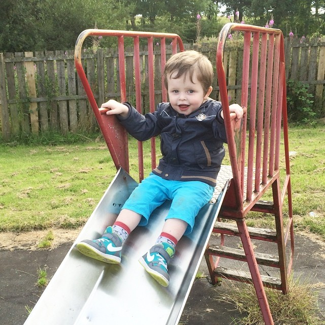 Someone enjoys the big slide! #playpark
