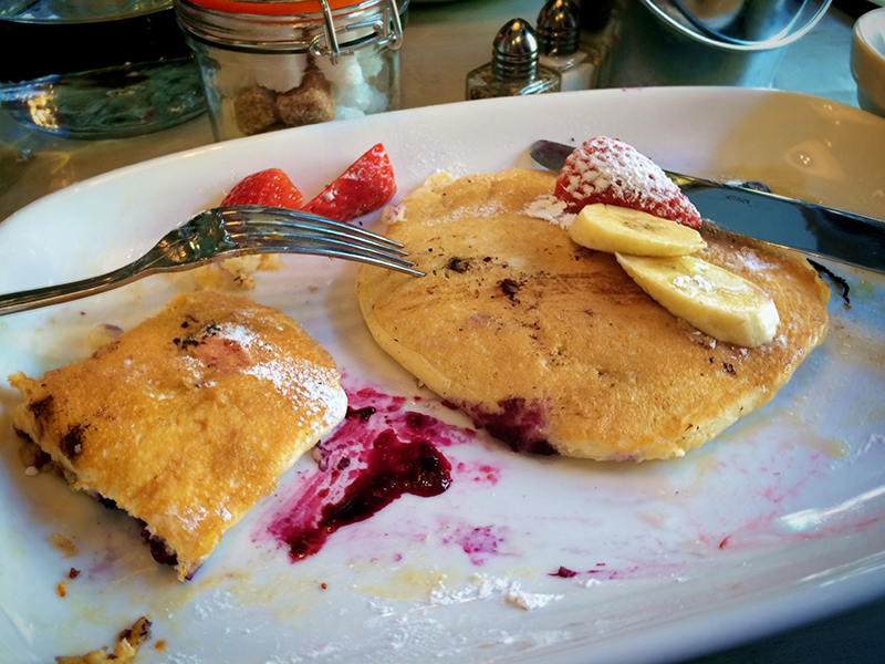 Bills Restaurant Glasgow- Blueberry Pancakes with Strawberries and Bananas Half Eaten