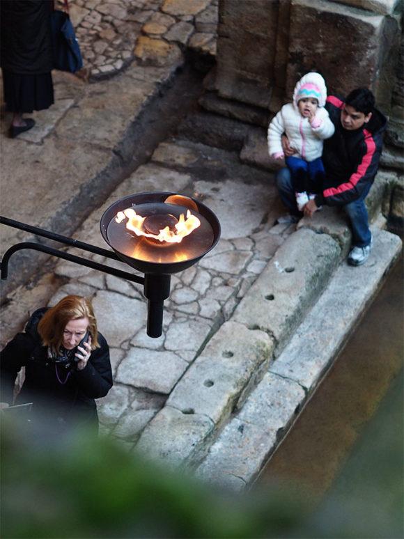 Exploring The Roman Baths- Great Bath visitors